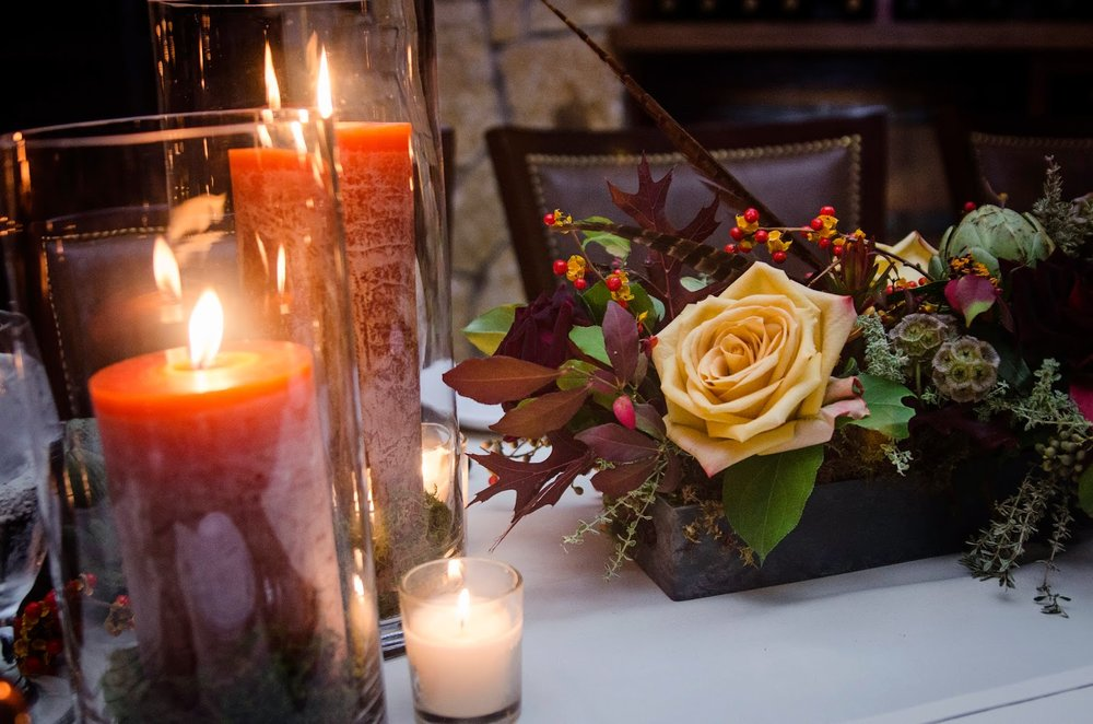 les fleurs : tuscan kitchen : orange pillar candles, moss in glass cylinder : fall