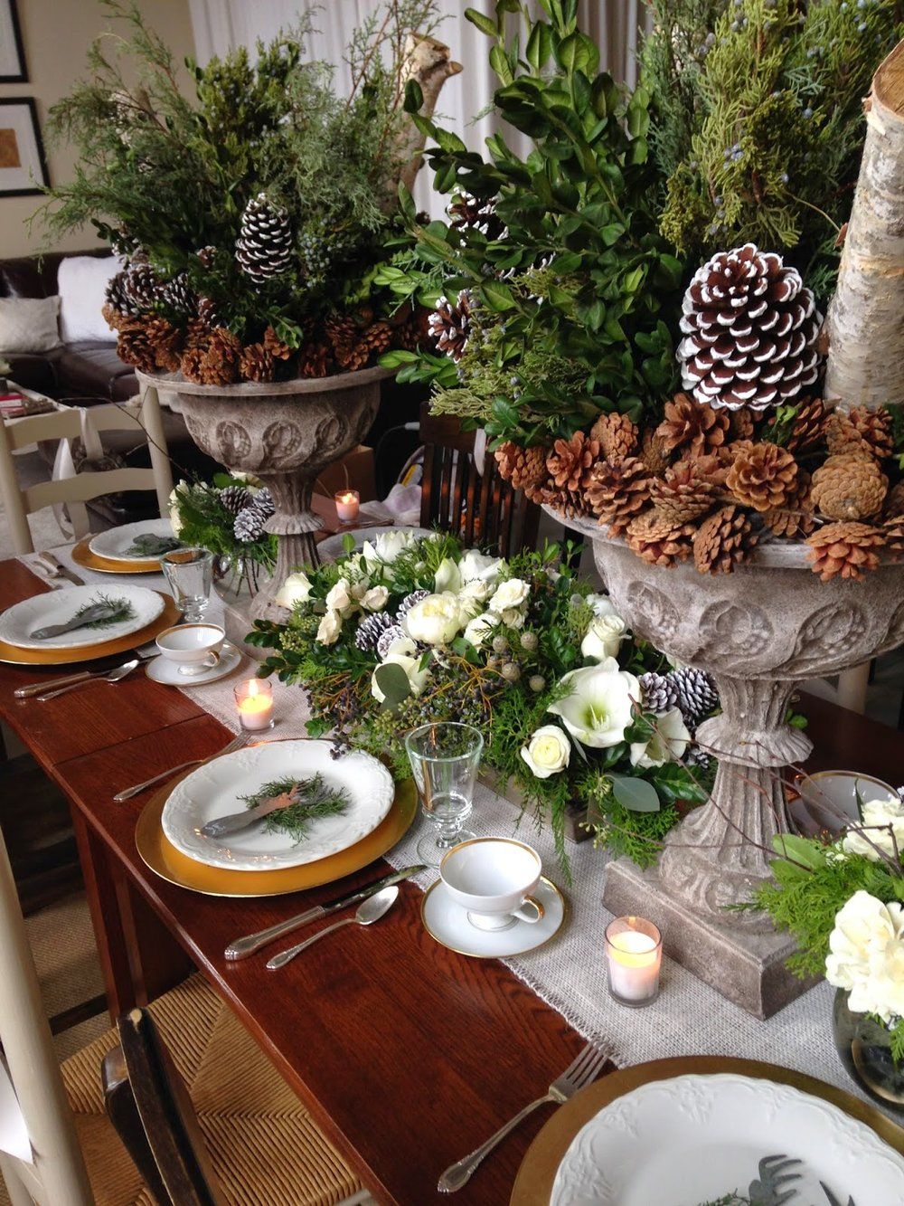 les fleurs : holiday urns : pine cones, birch, german boxwood, carolina sapphire : dining christmas table