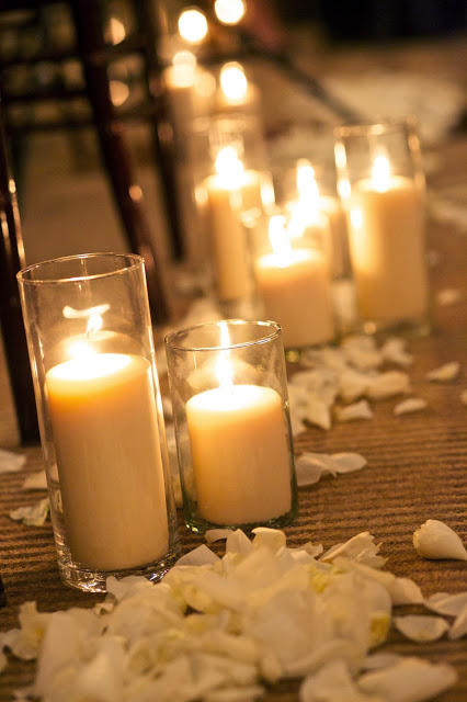 pillar candles and rose petals for aisle