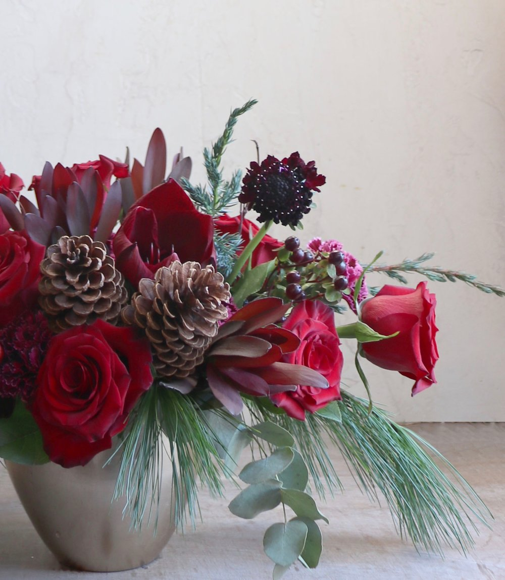 lesfleurs holiday centerpiece red roses pinecones