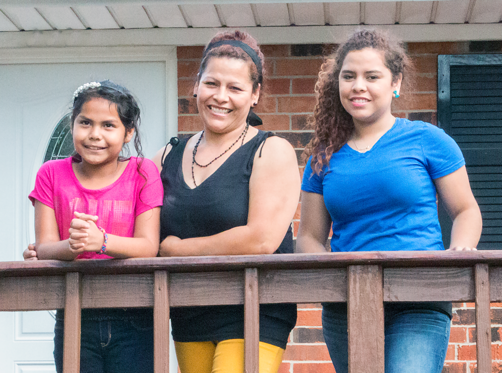 Tomasa Sanchez and children outside their new home.