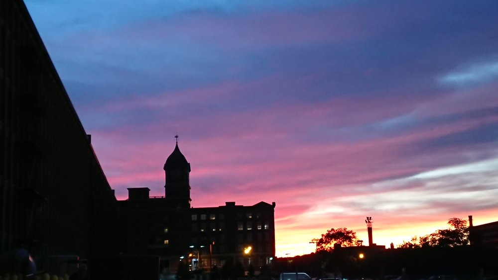 Photo of the City of Lawrence, Massachusetts showing historic mill buildings at  Riverwalk  where Station1 is located.