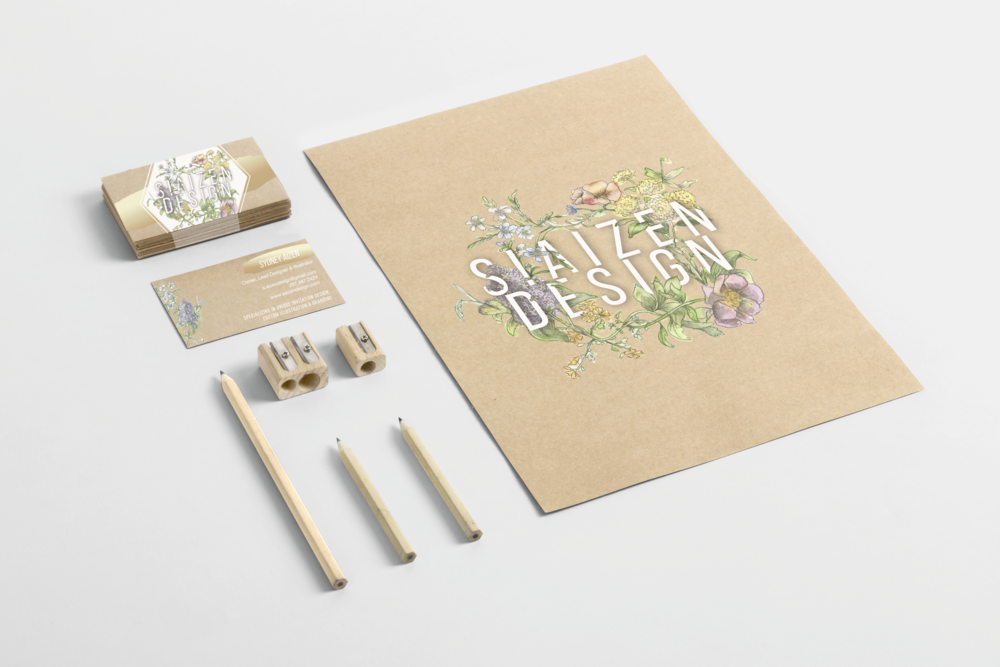 Branding created for our company!  Featuring hand-drawn and painted florals on kraft stock.  Pictured are our folders and business cards.