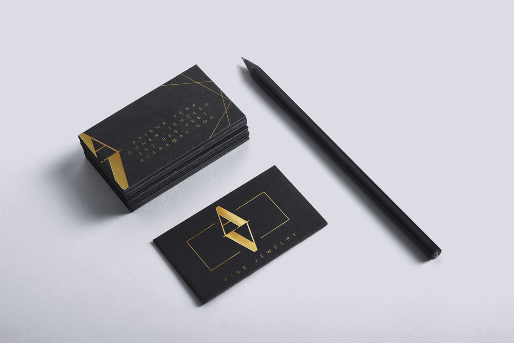 Branding created for a local jewelry maker, created using gold foil on black matte stock.  Pictured are business cards.
