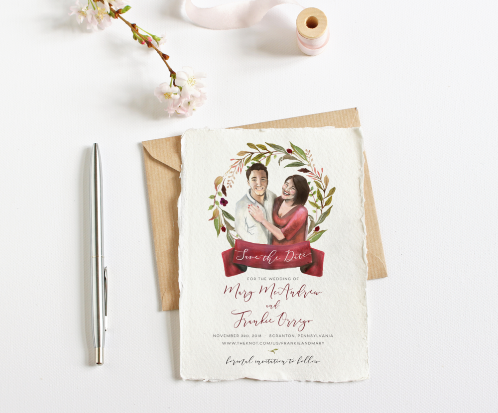 Red and gold foil printed invitations with geometric accents for a Christmas-time wedding.