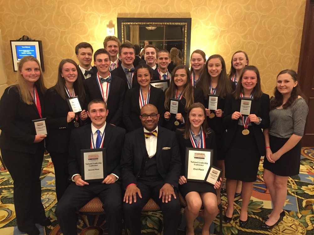 2018 NLC - Parliamentary Procedure Team Winners - Midland HS 2nd place (left) and Stephenson HS 1st place (right) with State Director M. Henderson