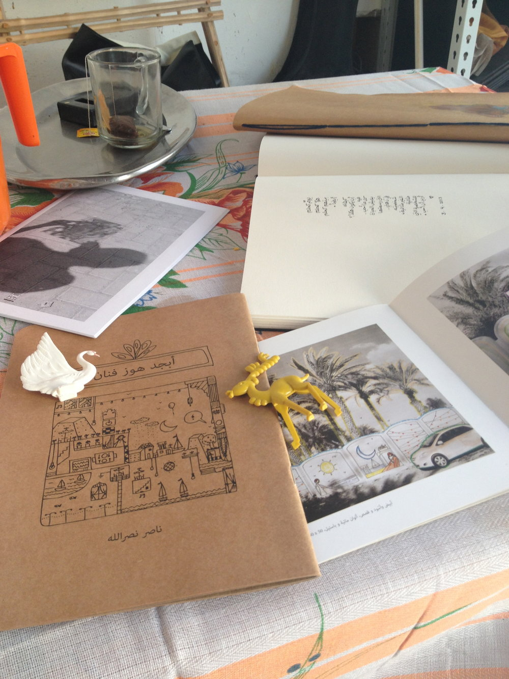 Tea, flipping through sketchbooks and artist gifts