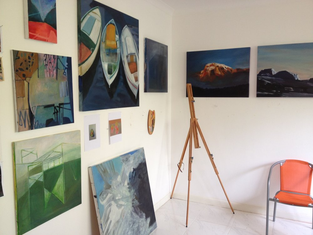 Jill Thomas Whately's light and airy studio filled with oil paintings and experiments