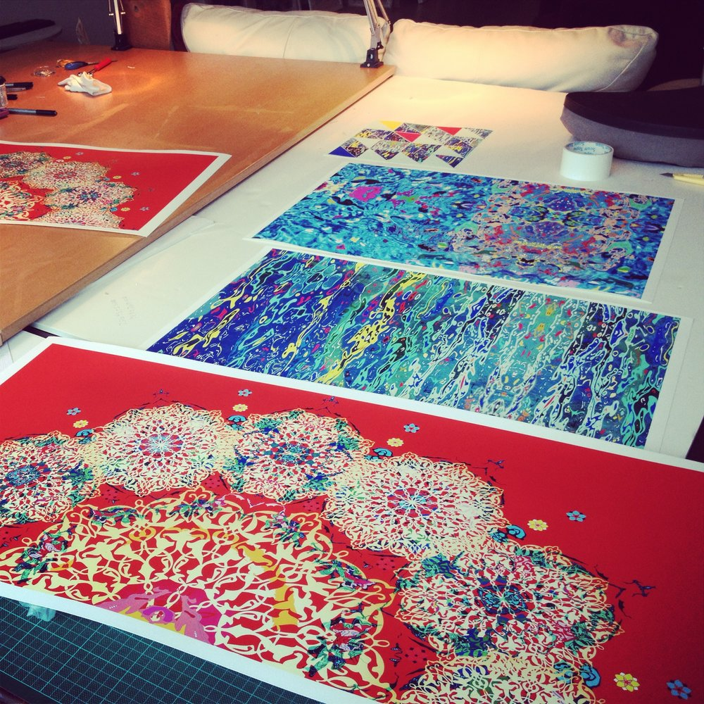 Sample digital prints laid out ready for hand embellishment