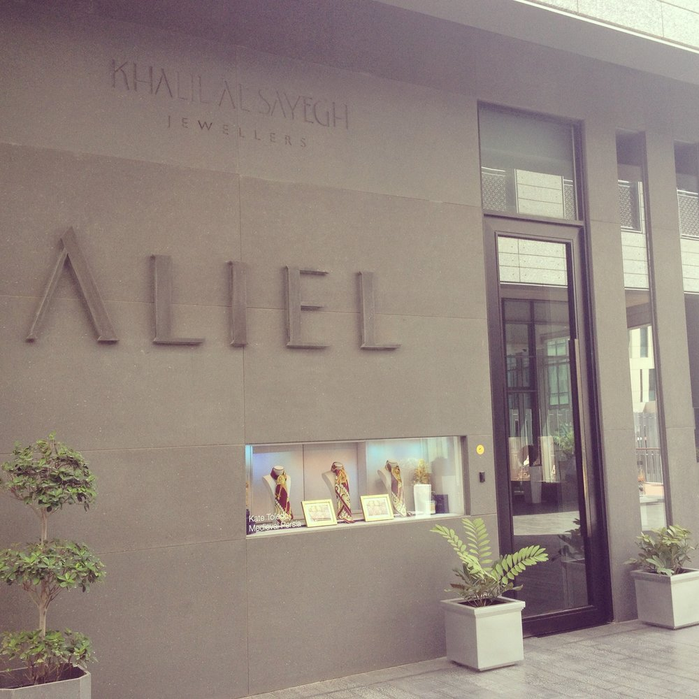 Aliel Jewellery Showroom at DIFC Gate Village displaying Kate Toledo's silk scarfs in the window