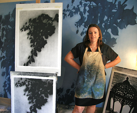 Artist Kathryn Ryan in her studio with her Dubai collection of charcoals and oil paintings
