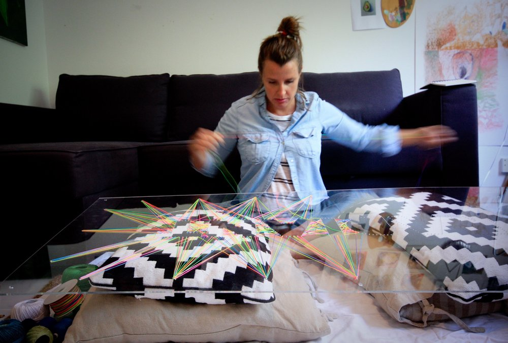 Artist Jill Thomas Whatley working in her Dubai studio