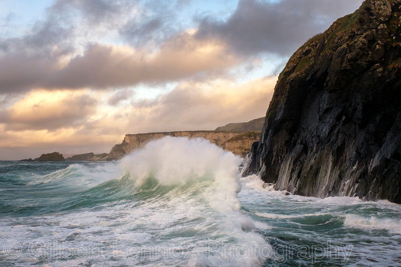 Photo Of Waves Against Cliff By Gilbert Lennox