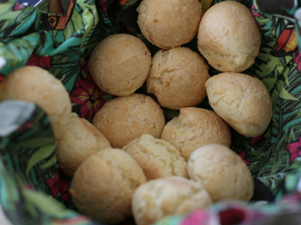"Pão de queijo from Margaret (Brazil)   ""Pão de queijo are made with mandioca flour and cheese. In Brazil they are a typical snack, comfort food and many people serve them at parties. Kids love them, and maybe adults love them too because it brings back the childhood memories:) ! """