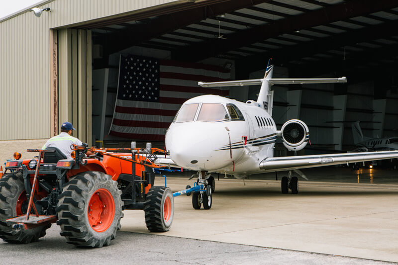 Contour airplane being pulled from a hangar by a tractor - Smyrna / Rutherford Country Airport Authority