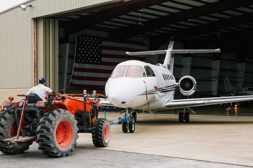 contour airplane being pulled from a hangar by a tractor smyrna rutherford country airport