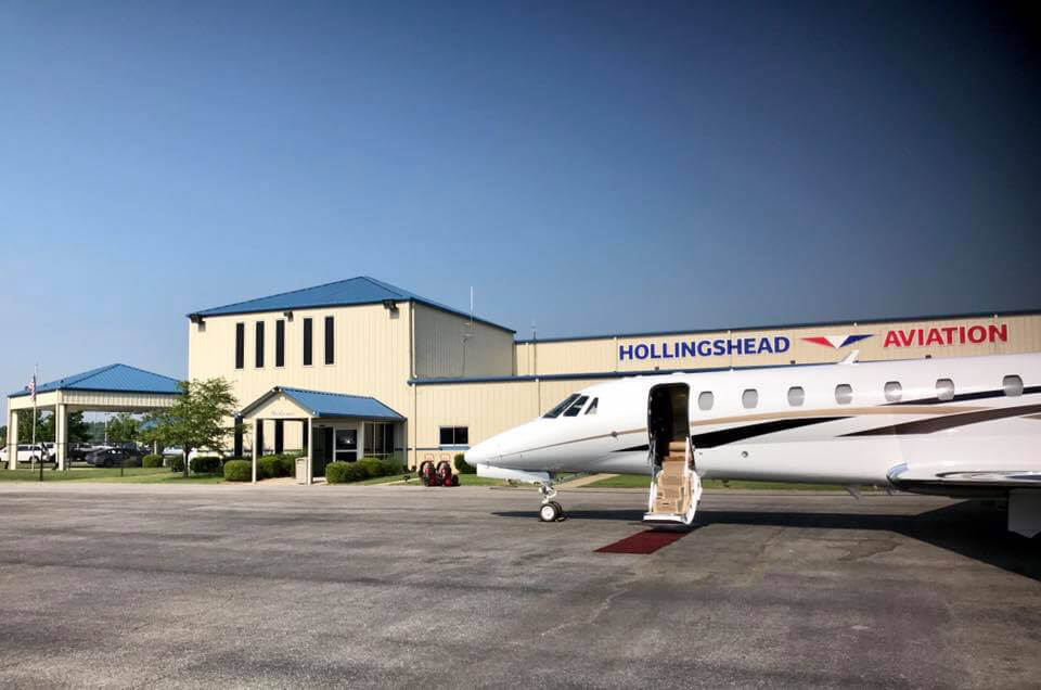 Small passenger jet parked in front of Hollingshead Aviation Building- Smyrna / Rutherford Country Airport Authority