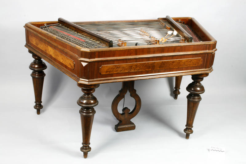 A cimbalom. Used to double the piano intro.