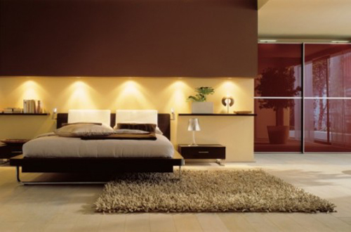 A simple design with great task lighting used in this modern bedroom.