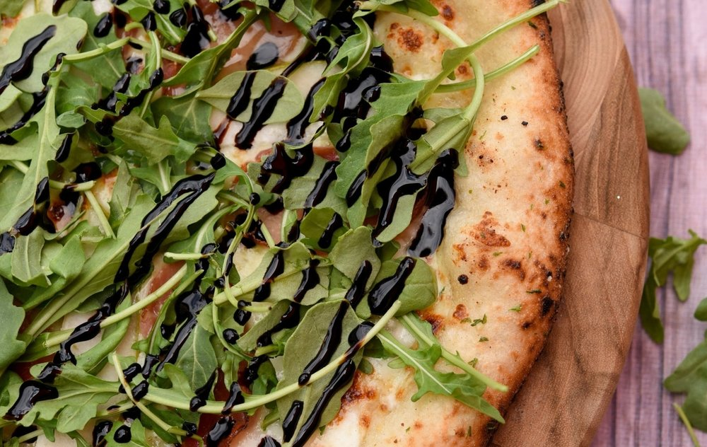 the northwestern. $11/21 - GARLIC BUTTER SAUCE | PROSCIUTTO | PEAR SLICES | TOPPED WITH ARUGULA & BALSAMIC REDUCTION