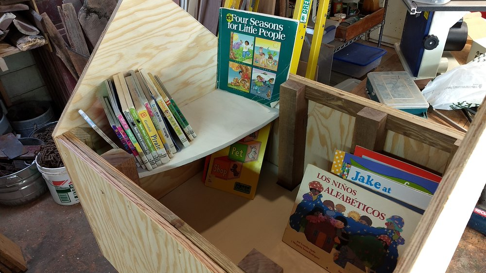 Trial fit with several children's books. The shelf allows more small books to go in the library.