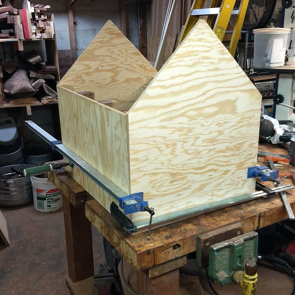 """The outside of the library is a marine-grade plywood. After sanding and priming, the sides and ends become """"canvasses"""" for the artist to work on."""