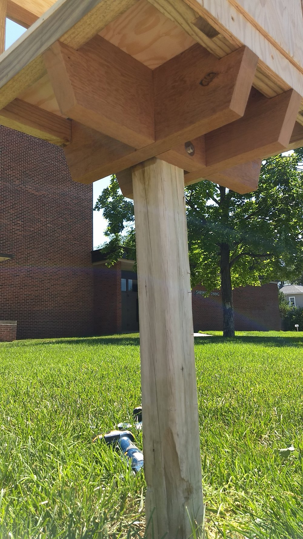 View from below. Here we are test-fitting the mounting system on the existing post. It will work just fine.