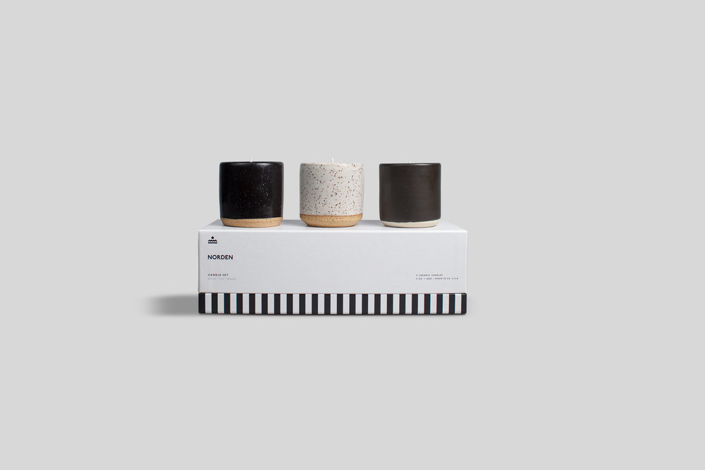Norden Goods - 3 pack candle set. This set comes with three 5 oz. ceramic candles - Øresund, Ojai, and Big Sur. Each candle is made with a coconut/apricot wax blend and comes in a beautiful, modern, & reusable stoneware container.