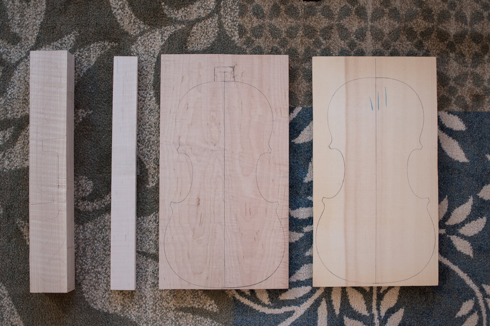 The starting point for making an instrument, blocks of maple and spruce. From left to right: neck block, ribs, back, face.