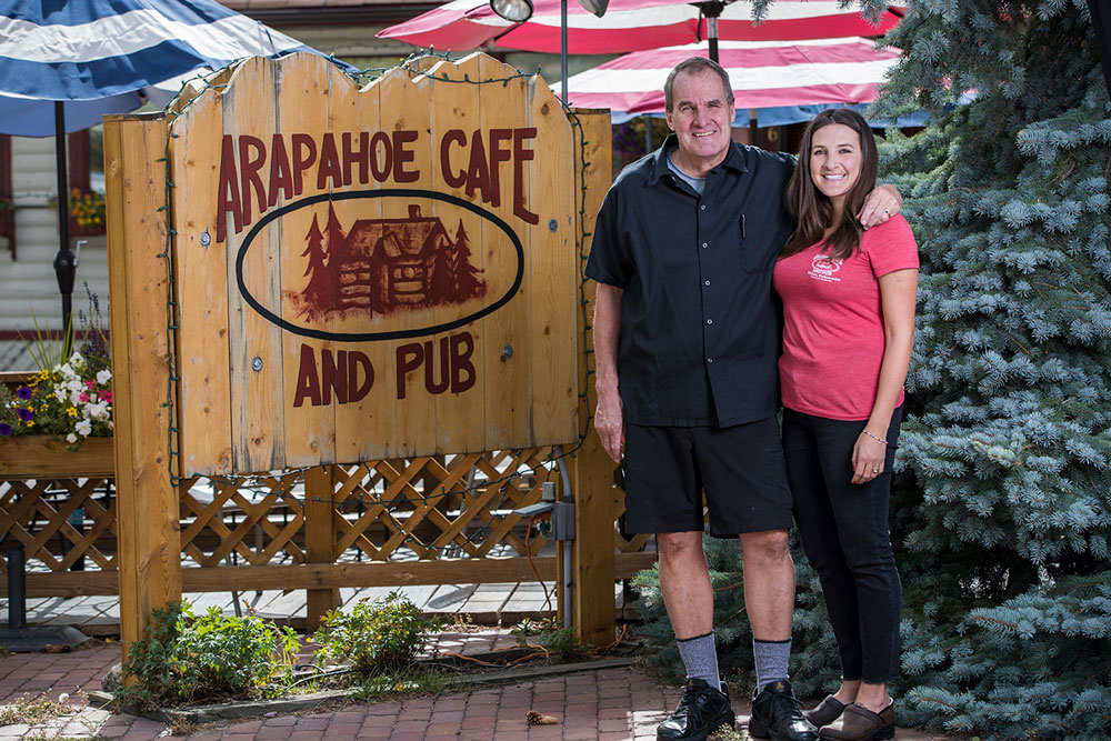 owners-doug-and-bonnie-smiling-out-in-front-of-the-arapahoe-sign.jpg
