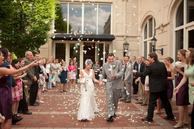 Flower petals gave the Roller-Bailey wedding exit a romantic feel. Photo by Lori Hedrick.