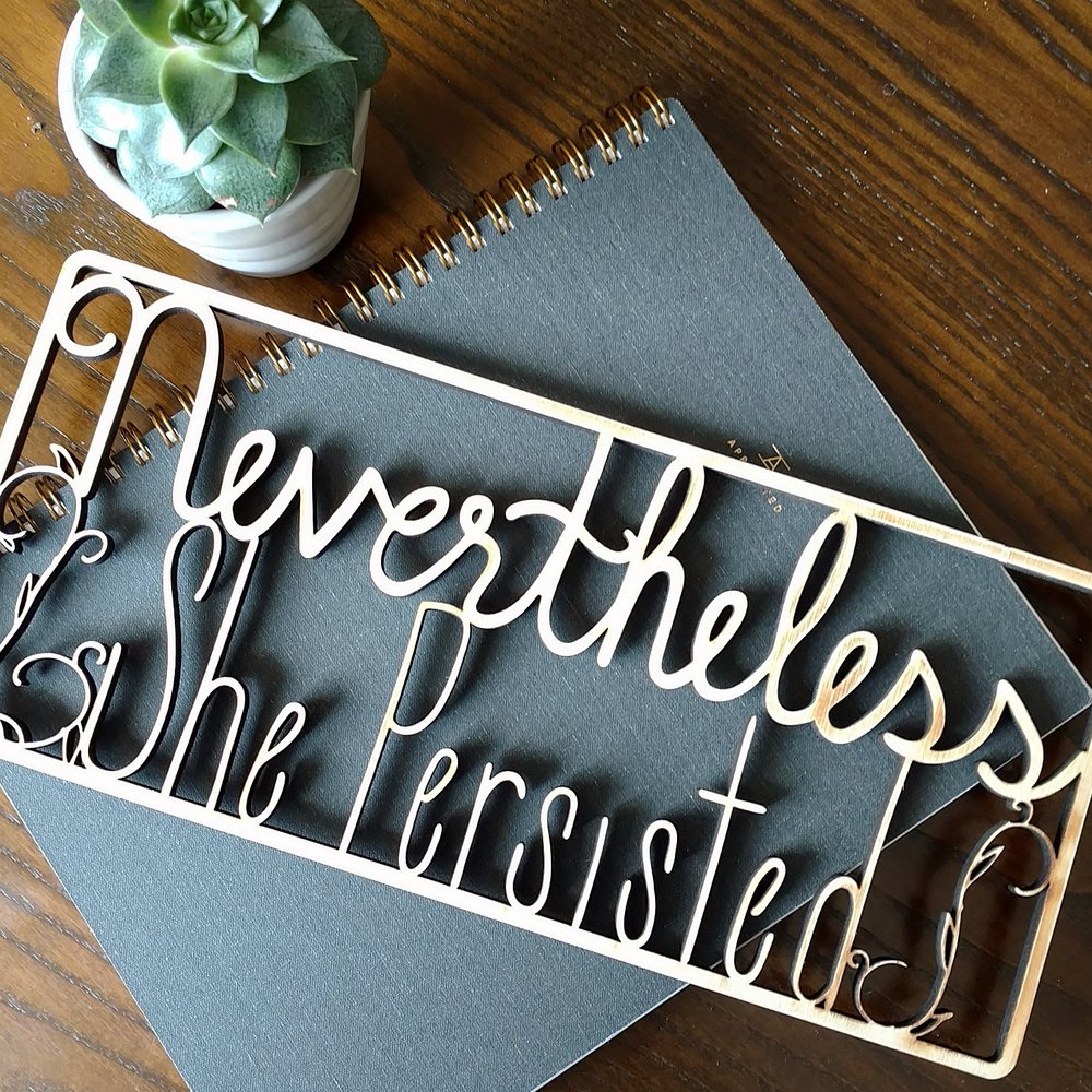 Meekly-Yours-Nevertheless-She-Persisted-Laser-Cut-Wood-Sign.jpg