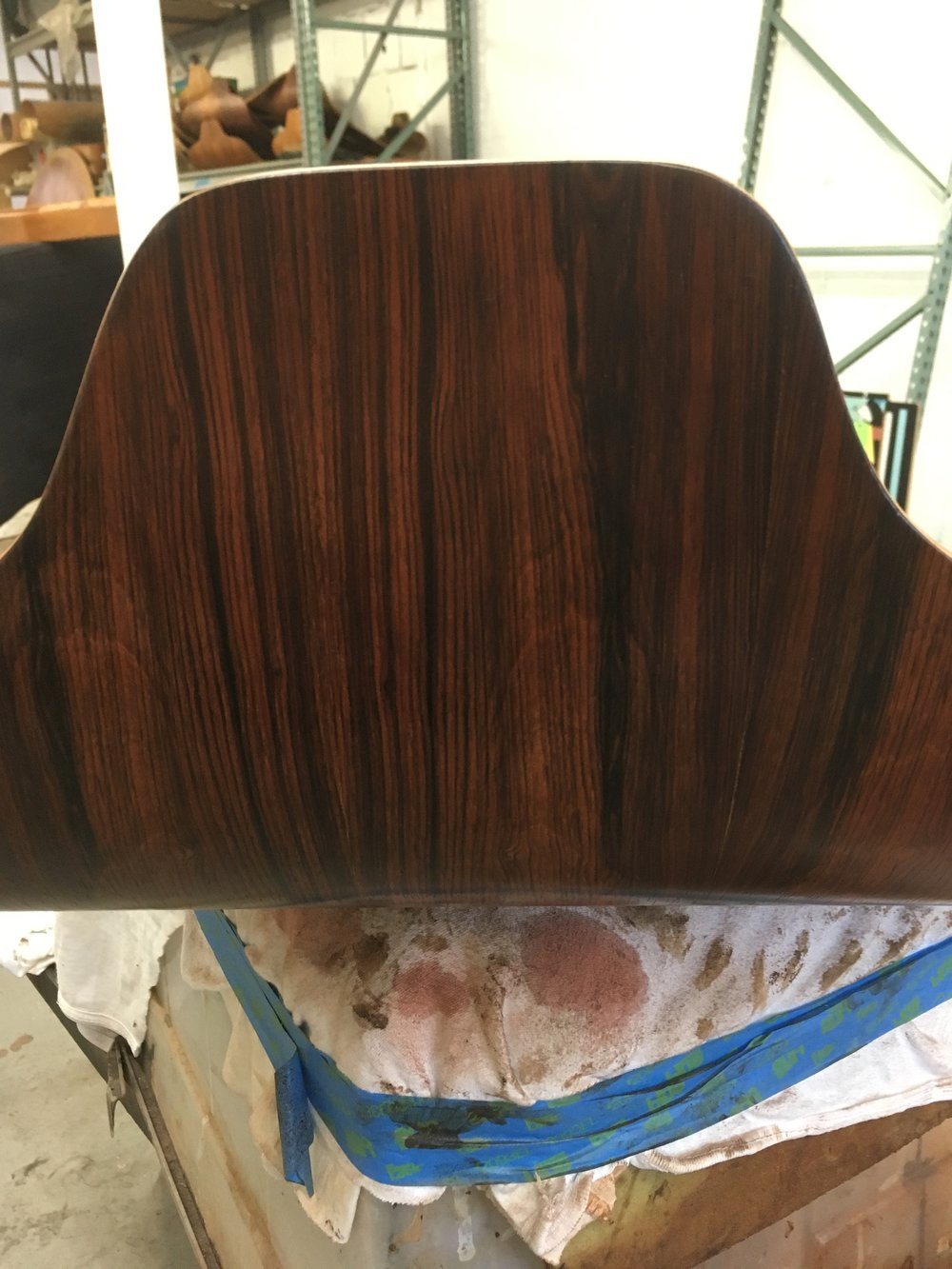 Repair of holes on an Eames Lounge