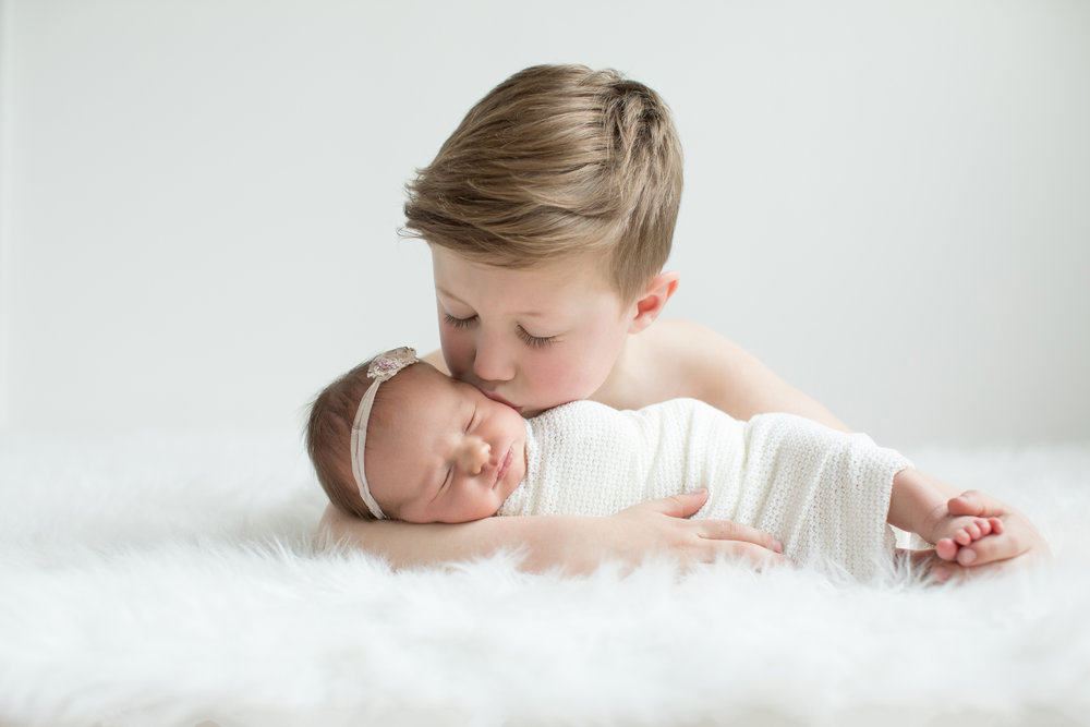 brother-with-newborn-sister.jpg
