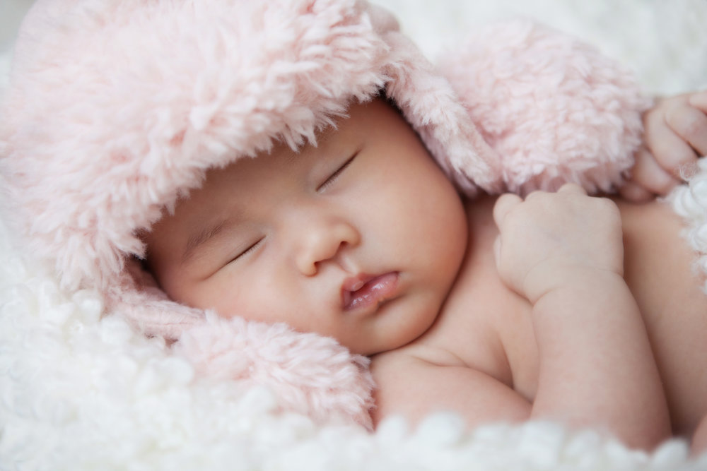 newborn-girl-in-pink-fuzzy-hat.jpg