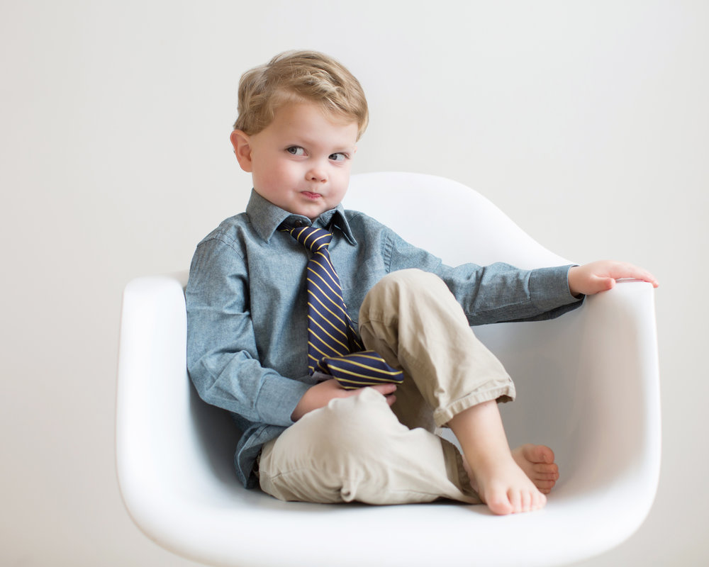 boy-in-eames-chair-making-silly-face.jpg