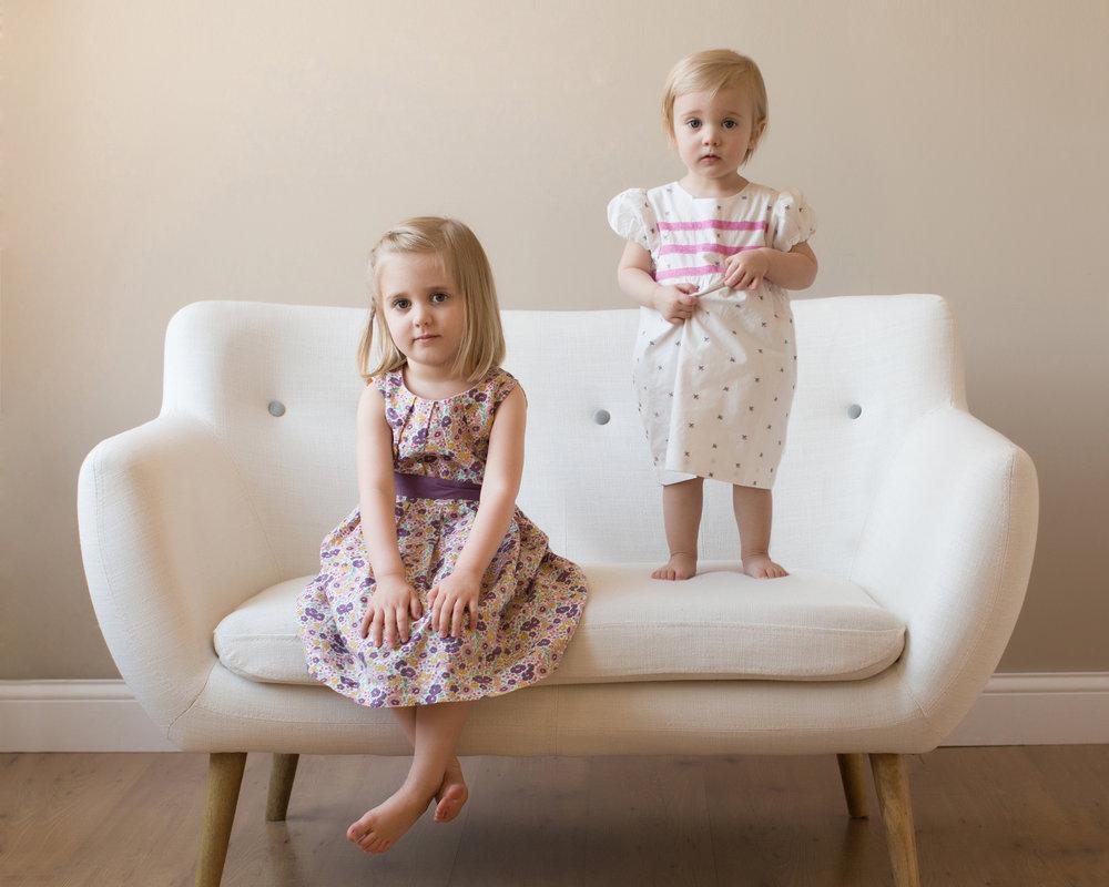 sweet-little-girls-on-couch.jpg