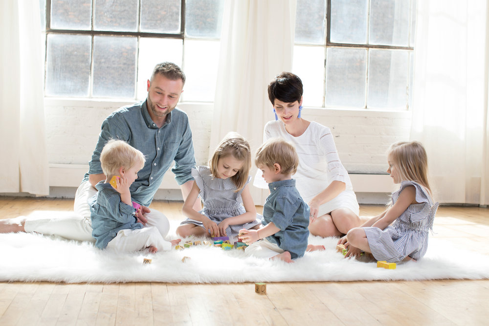 beautiful-family-sitting-on-the-floor-smiling.jpg