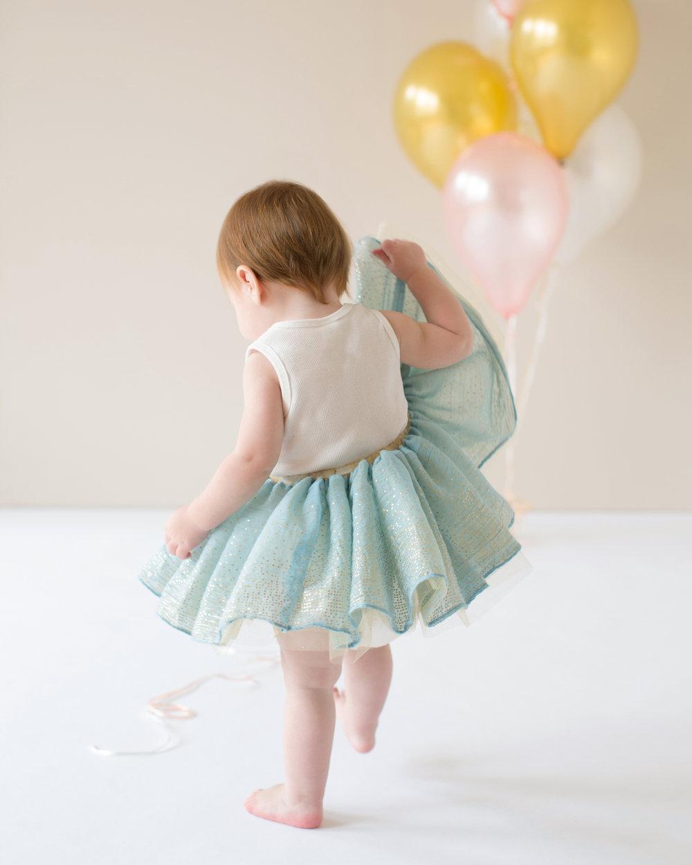 little-girl-holding-tutu.jpg