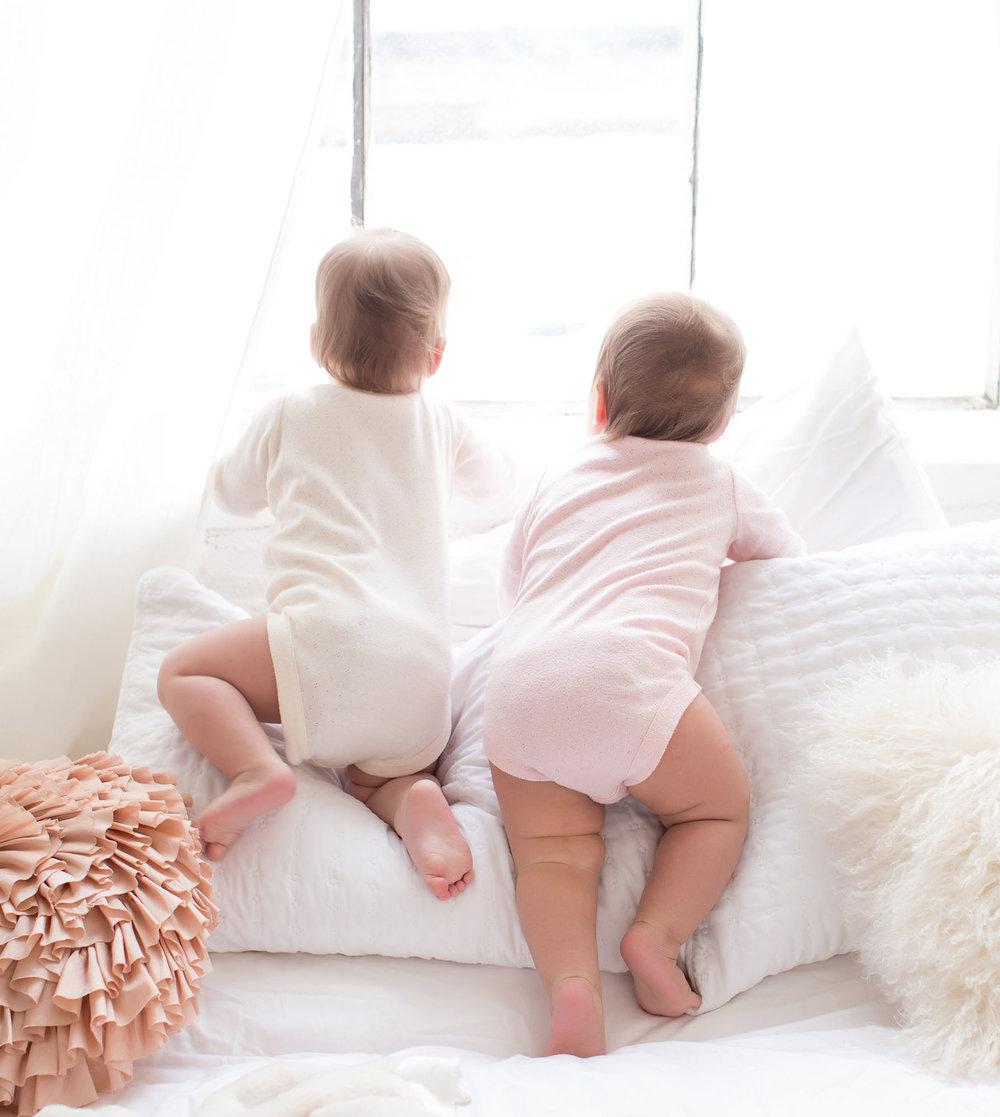 twin_babies_climbing_pillows.jpg