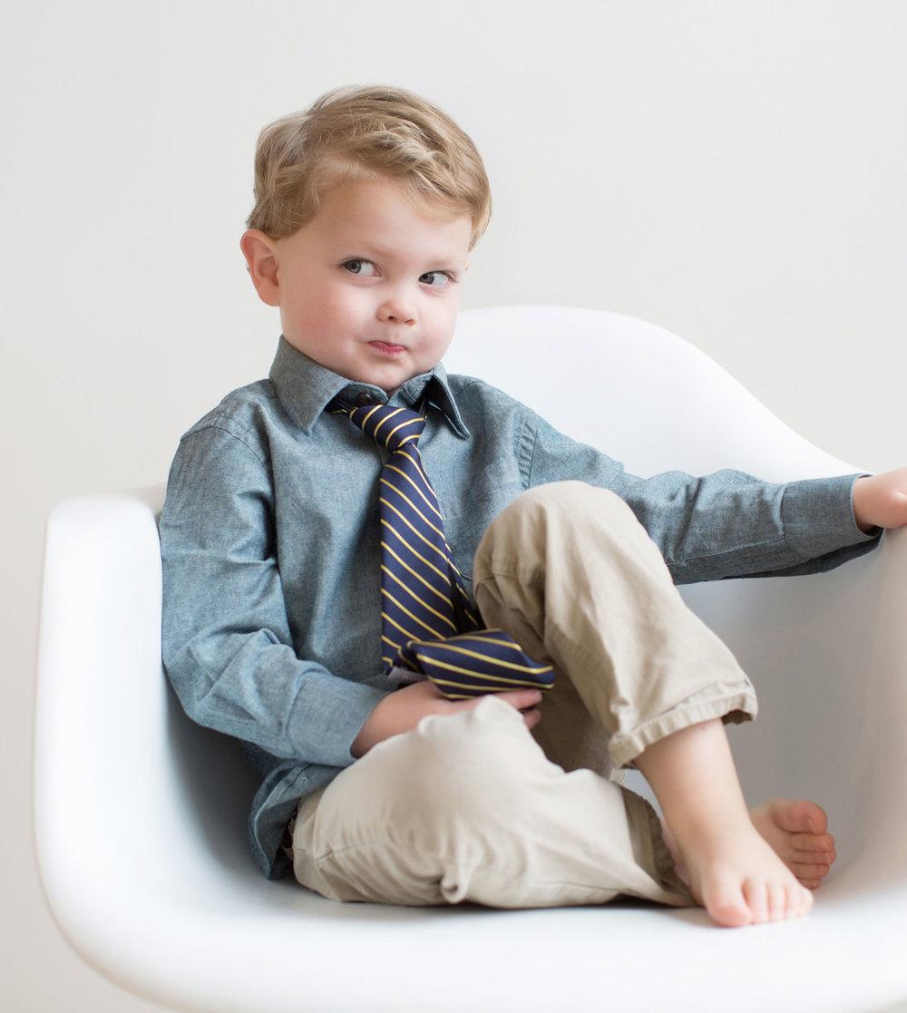boy_in_modern_chair_looking_silly.jpg