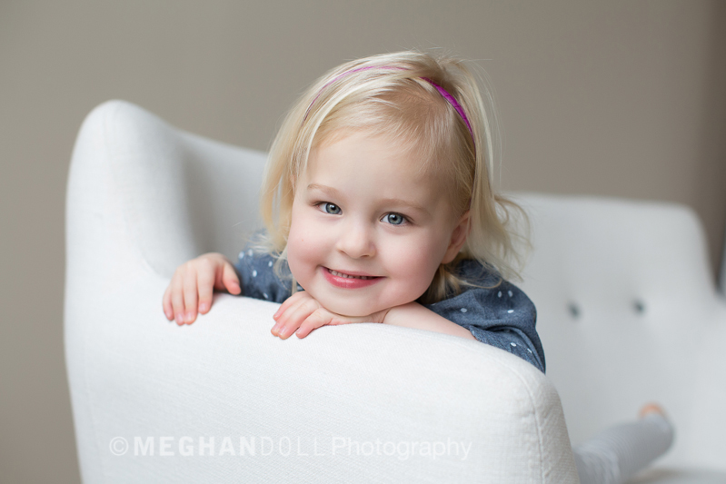 cute little blonde girl on couch