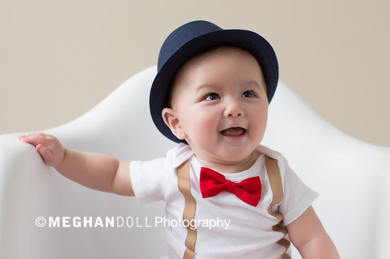 happy baby boy in fedrora