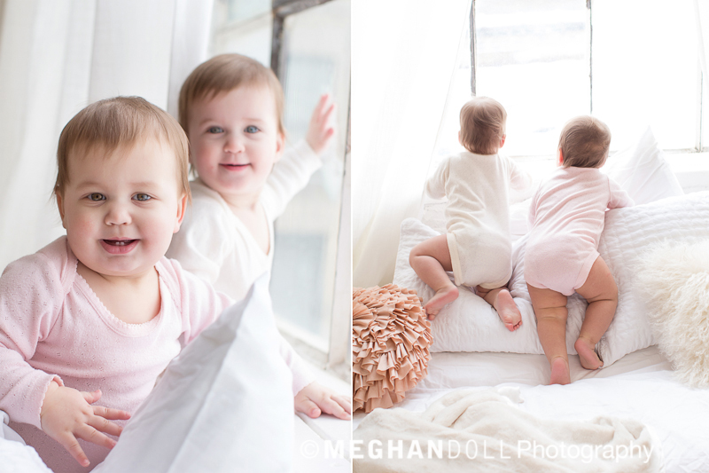 Twin baby girls climbing up to window. Active and adorable.