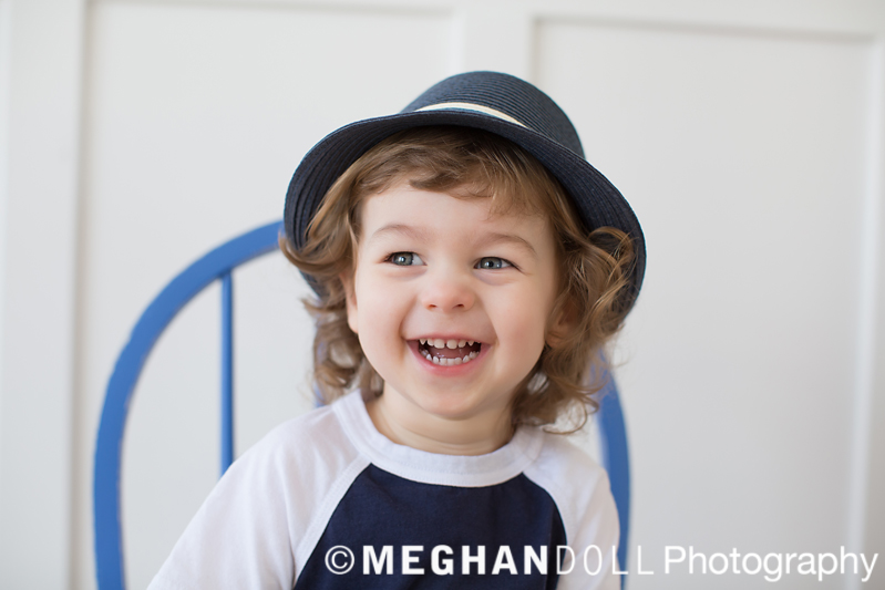 Big smile on little boy wearing a fedora