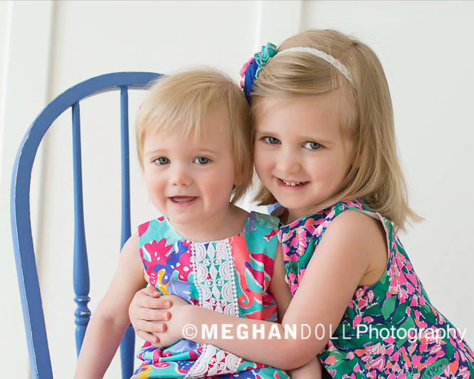Close up of adorable little girls in bright, colorful dresses.
