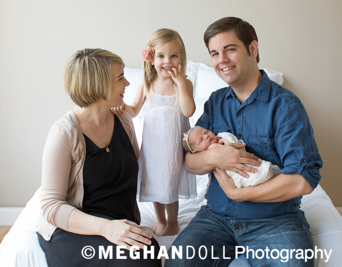 Family with newborn baby girl.