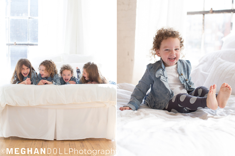 four silly cousins make each other giggle on the cozy bed in the warm sunshine