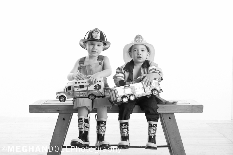 brothers dressed up as firemen show off their new emergency rescue trucks