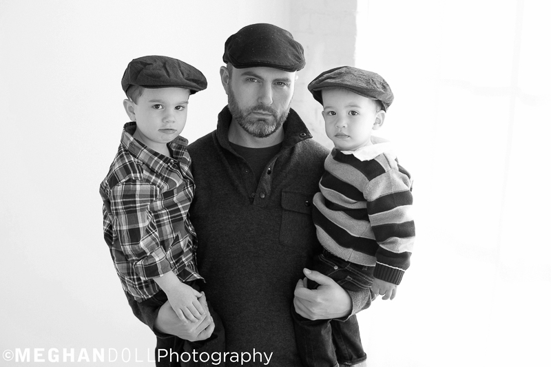 dad and boys in matching hats give their best serious model faces
